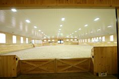 Half walls allow horses to enter the arena without appearing from behind a blind corner which can cause spooks.