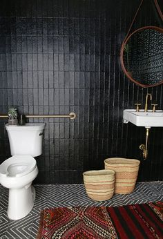 This bathroom goes bold with dark colors, a vintage rug, handmade textiles and tribal pattens.