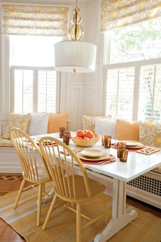 Table for breakfast room with vented bench and opposing chairs. Different colors