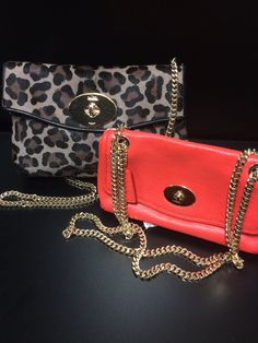 Coach Chain Purses  - Chain is the perfect way to up the wow factor of your outfit. These two are the perfect wow factor. The red one is $120, nice soft leather. The leopard print is fur at $250 both new with tags.