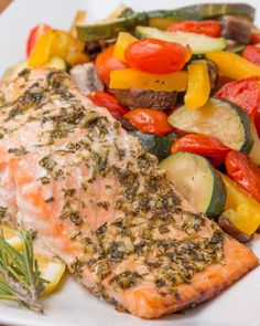 Salmon Recipes Discover One-Pan Lemon Herb Salmon And Veggies One-Pan Lemon Herb Salmon And Veggies Salmon Recipes, Fish Recipes, Veggie Recipes, Seafood Recipes, Cooking Recipes, Healthy Recipes, Lemon Salmon, Baked Salmon, Lemon Herb Salmon Recipe