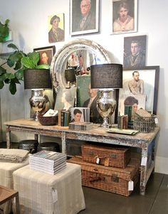 silver lamps, black shades, chippy mirror, wicker trunks