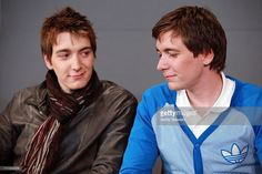 Oliver Phelps and James Phelps visit the Apple Store Soho on April 3, 2011 in New York City.