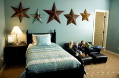 This bedroom is just like our living room. The aqua walls, the big nautical stars, dark dark brown or black furniture, and stripes! <3