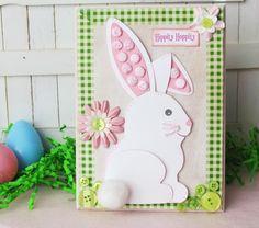 une carte de Pâques DIY décorée d'un lapin blanc et un pompon