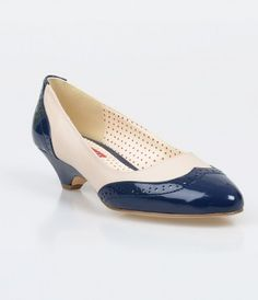 Ida has captured our full attention, darlings. A kittenish pair of sheeny pointed toe pumps, these navy and cream patent...Price - $66.00-H4NdcLQP
