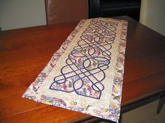 """'Celtic Koi'   Design: Nancy Chong, 2006  Hand-made, hand and machine quilted   Special notes:  On-line course """"Stress-free Celtic tablerunner"""" given by Nancy Chong at the Quilt University."""