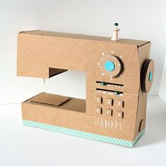 Make an adorable play sewing machine out of an old cardboard box!