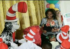 First Lady Michelle Obama with the Cat In The Hat at the White House