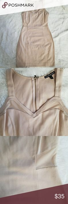 Express nude dress Nude dress never worn has mess on the back sides and top of clevage area beautiful fit size 2. Express Dresses