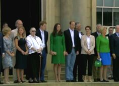 July 5, 2014 - William, Kate and Harry as the national anthems are played. Ceremonial ribbon cutting next.