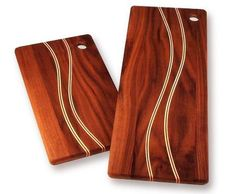 Walnut cutting boards with curved inlays