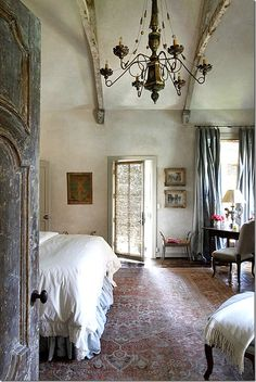 babette1:    The master bedroom with Nancy Corzine curtain fabric & Tabriz rug. (via My Italian House….one day)