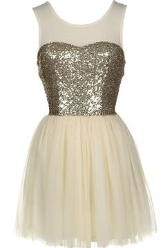 Sugar Storm Dress: Features a chic mesh yoke with illusion sweetheart neckline, glittering gold sequin bodice, centered rear zip closure, and a super feminine mesh ballerina skirt to finish.