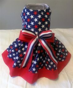 ThePet-Boutique's Exclusive Design! Our patriotic dog dress is a beautiful print of red and white stars on a blue background. Our dog dress is trimmed with a matching red ruffle and is embellished with 2 coordinating bows.  The dress is fully lined and made from 100% cotton.  Perfect for small and big dogs!
