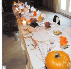 Long tables were decorated with pumpkins elaborately carved by the bride. Colorful fall leaves and branches with berries were sprinkled around glowing candles on the tables.
