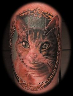 fuckyeahtattoos:    Cats Rule Everything Around Me  This is my cat, who I've had for only 4 years but love more than anything. The tattoo came out perfect and it's all thanks to Marcus Lund at Old 7th Avenue Tattoo Shop in Ybor, FL.  Sorry for the blood, this picture was taken right after I got it.