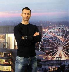 @manutd legend Ryan Giggs poses in front of the Manchester skyline.