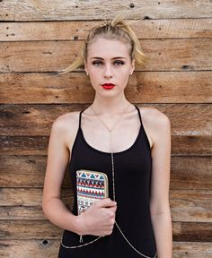 A classic Black Tank to stand out with your Red Lip & Tribal Wallet from @HiStreetUSA PLUS a dash of sass with your Dainty Body Chain to show off the figure.