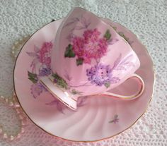 Lovely cup and saucer made by Tuscan in England. A very pretty pink duo with flowers on both the cup and saucer. Both pieces at in good