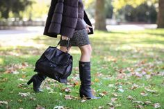 Louis Vuitton cape, Prada tote black bag, Prada boots.