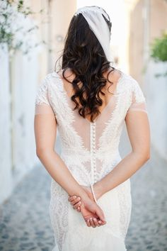 Dreamy lace wedding dress: http://www.stylemepretty.com/destination-weddings/2016/03/31/a-sunset-destination-wedding-in-santorini-full-of-magic-romance/ | Photography: Tyme - http://www.tyme.co.za/