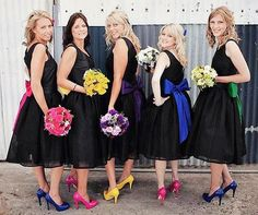black bridesmaid dresses with bright coloured shoes which match the bridesmaids flowers and bows
