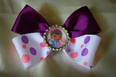 purple, pink and white dotted bow using Doc McStuffins embellishment, hair bow, hair clip
