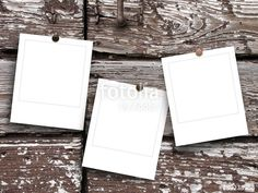 Three blank square photo frames on brown wooden boards