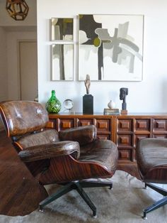 Eames style distressed leather and rosewood swivel lounge chair and ottoman.