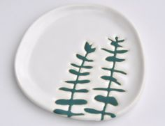 Hope Johnson - Ceramic plate  Wax resist method of simple shape plates