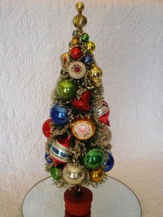 Tall vintage bottle brush Christmas tree I decorated with antique ornaments.  These trees are some of my favorite Christmas decorations.