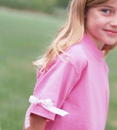 For a pretty t-shirt sleeve: Sew button holes, snip open, thread ribbon.