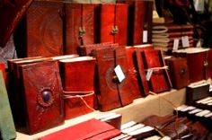 Some lovely journals on a market stall.