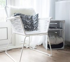 Bring a HÖGSTEN chair inside for the winter to make a great reading seat | Rachel's home in Amsterdam | Follow her at boringthngs.com | live from IKEA FAMILY