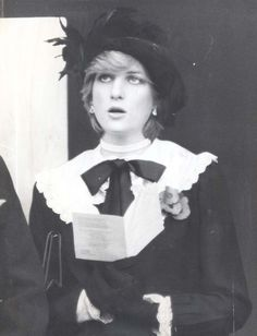 Diana joins in a hymn during the Cenotaph service in November 1981