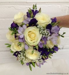 Purple and cream wedding flower Bridal Bouquet with ivory avalanche roses, purple lissianthus, lilac freesia and gypsy grass Wedding Flowers Liverpool, Merseyside, Bridal Florist, Booker Flowers and Gifts, Booker Weddings