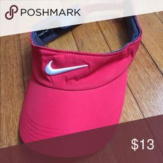 Red Nike Golf Visor Red Nike Golf Visor, never worn! The picture makes it look a little lighter but it's RED Nike Accessories Hats