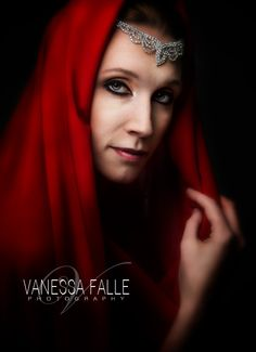 Red is the single color focus in this image. The model is depicting Mary Magdalene.