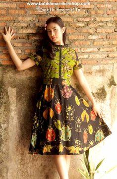 batik amarillis's rive gauche dress www.batikamarillis-shop.com 'Elegantly beautiful & timeless dress with flowing hemline such a charming dress accented with panelled detailing & contrast trims Made of hand drawn batik wonogiren-Indonesia