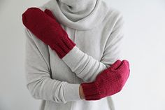 A simple and handsome pair of mittens in a quick-knitting aran weight yarn. Mitts are knit in the round in one piece. Stitches for thumb are placed on hold and the thumb is knit after the mitten is finished.