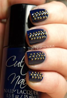"""Now this is an interesting manicure...""""The Nailasaurus: Stud Up! Day 7: Spots or Stripes?""""...(balls/beads/studs on blue nail polish)"""