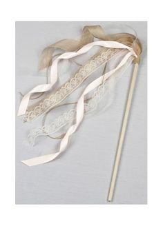 Incorporate this whimsical wand into your wedding with your flower girl, ring bearer, or wedding guests. Lace organza jute and David\'s Bridal exclusive ribbons are wrapped around a wooden rod to crea Wedding Ribbon Wands, Diy Wedding, Wedding Day, Dress Wedding, Lace Wedding, Wedding Decor, Wedding Ceremony, Wedding Gifts, Flower Girl Wand