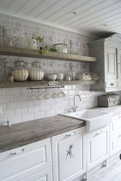 Floating shelves are our favorite! This farmhouse kitchen is spectacular!