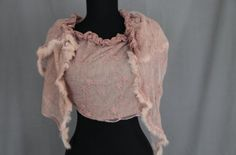 Cotton lace scarf with faux fur. Half of the scarf is lace with embroidered floral design and faux fur edging.