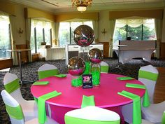 Not crazy about the centerpieces, but the colors are perfect. Electric green and hot pink table setting