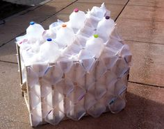 #Pet house made from shipping pallet and #recycled milk bottles!