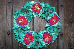 Rag Rug Wreath - can you believe that this is made from old t-shirts that the thrift shop couldn't sell?! Yep! And so easy and pretty to make too.
