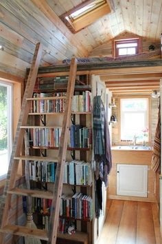 April Anson's 120' sq home manages to fit a whole wall for books.   (Correct link; photo is #9 on the slideshow.)
