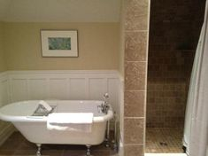 Bathroom with clawfoot tub and shower